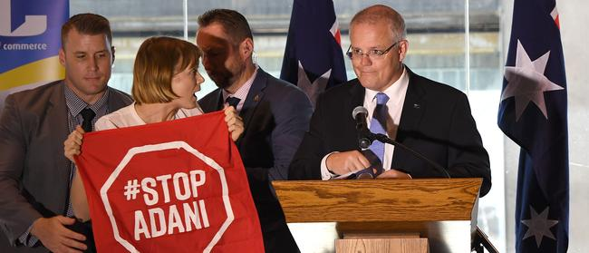 Anti-Adani protesters disrupted a business lunch speech by the Prime Minister in Brisbane on Monday. Picture: Dave Hunt/AAP.