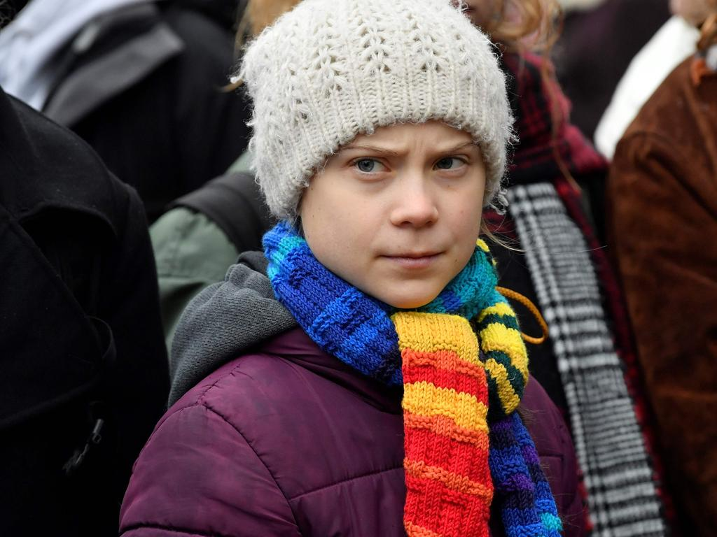 Swedish climate activist Greta Thunberg observes while participating in a