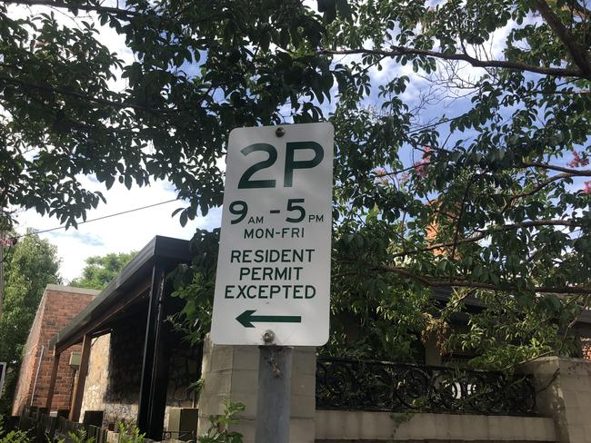 For reference, this is what a normal parking sign looks like.