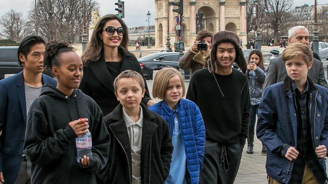 Angelina Jolie pictured during a trip to the Louvre in Paris with all the kids back in January 2018. Left to right: Pax, Zahara, Knox, Vivienne, Maddox and Shiloh. Picture: Marc Piasecki/GC Images