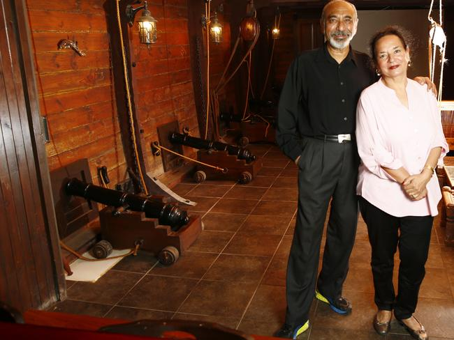 Nishi and Kokil Parikh in their home cinema with timber walls, cannons and rigging.