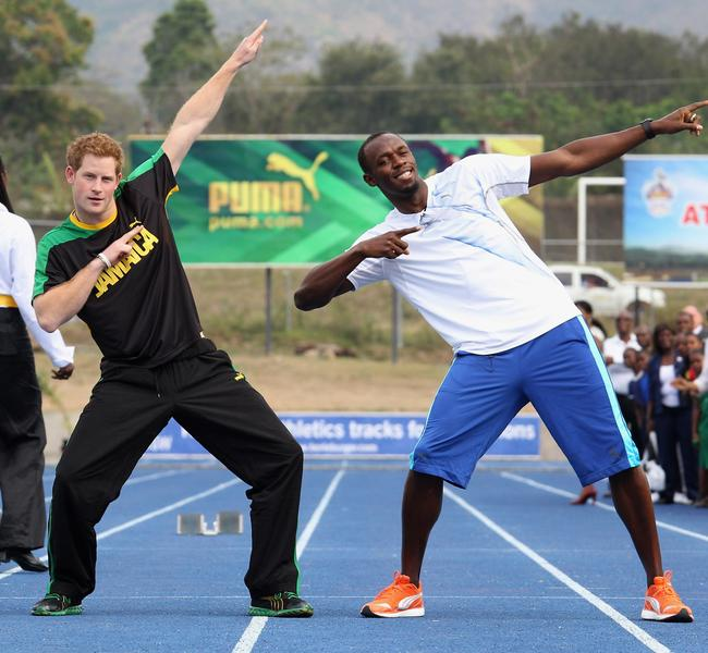 After his Vegas trip, Prince Harry was sent on official duties for the Queen in 2012. Here, he jokes around with Usain Bolt at the University of the West Indies. Picture: Chris Jackson/Getty Images