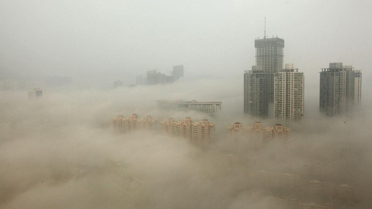 Buildings are shrouded in smog in Lianyungang, China in 2013. Heavy smog blankets many Chinese cities, particularly each winter. Picture: Getty Images