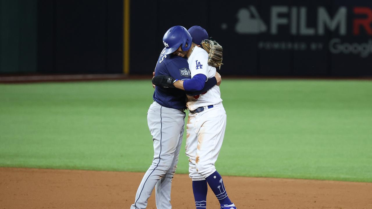 Mookie Betts with Willy Adames of the Tampa Bay Rays after stealing second base.