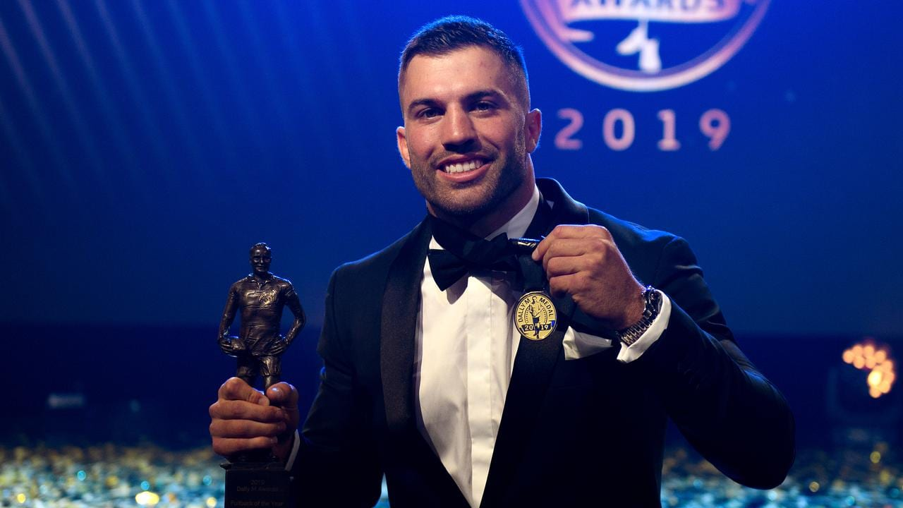 Sydney Roosters player James Tedesco poses for a photograph on stage