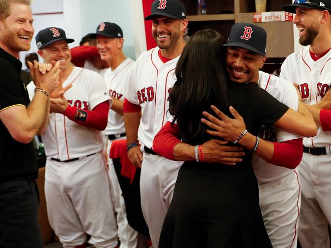 cee6eb1b2e38a Meghan gives a special hug to Red Sox superstar 'Mookie' Betts when he  tells her: 'We're kin!'
