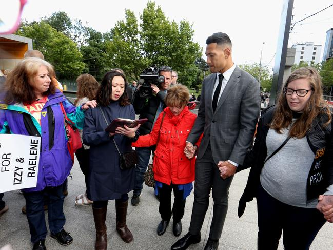 Folau joined in prayer with supporters at Federal court in Melbourne.