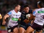 Patrick Kaufusi of the Cowboys is tackled by Dylan Walker of the Sea Eagles during the round three NRL match.