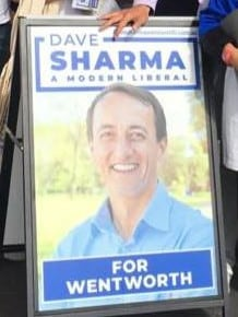 Dave Sharma's new election material has a big change compared to last year's signs.