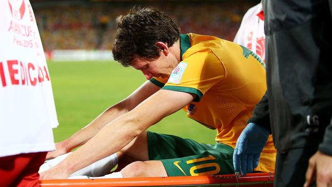 A visibly upset Robbie Kruse is stretchered from the field.