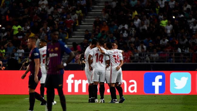 Sevilla's players celebrate after scoring a goal during the Spanish Super Cup final
