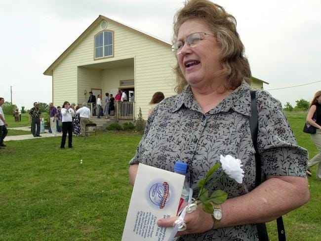 April 19, 2003: Bonnie Halderman, mother of the late religious group leader David Koresh, chats with members of the media following a 10-year-anniversary memorial service in the chapel where the group's compound once stood. Picture: Tony Gutierrez