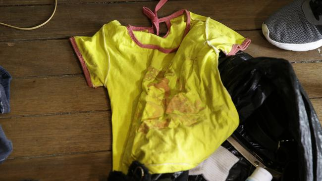 A child's T-shirt found on the floor as the raid continued. Picture: AP/Aaron Favila