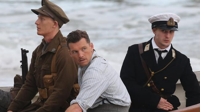 Fire ... Sam Worthington prepares for a scene in Deadline Gallipoli at Port Noarlunga. Picture: Dylan Coker
