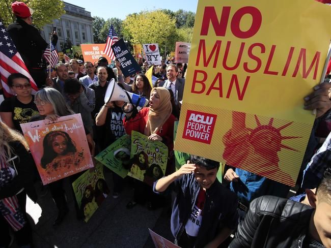Protesters gather at a rally in Washington in October this year. Picture: AP