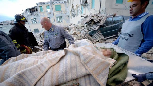 A woman, whose fate is unknown, is carried away by rescuers after a 6.2 magnitude earthquake struck central Italy.