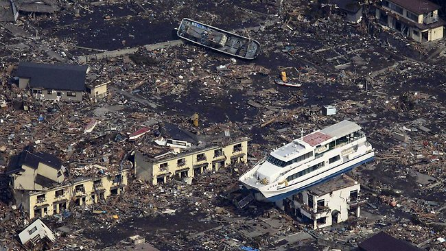 WIRE: This aerial shot shows a pleasure boat sitting on top of a building amid a sea of debris in Otsuchi town in Iwate prefecture on March 14, 2011 following the March 11 tsunami. A nuclear power plant damaged by An explosion rocked an earthquake-hit nuclear plant Monday, as Japan struggled to avert a catastrophic reactor meltdown caused by a quake and tsunami feared to have killed more than 10,000. JAPAN OUT RESTRICTED TO EDITORIAL USE AFP PHOTO / YOMIURI SHIMBUN