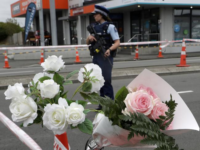 A police officer stands at a police cordon at an intersection near the Linwood Mosque in Christchurch. Picture: AP