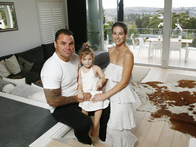 Watmough with his family at their old home. Picture: John Appleyard