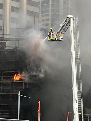 A sheet of scaffolding caught alight. Source: John Grainger/ News Corp Australia.