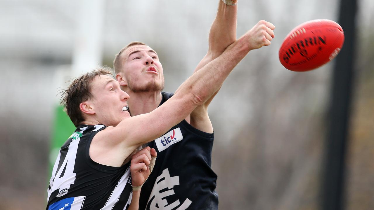 Collingwood's Jack Madgen battles with Carlton's Harry McKay. Photo: Michael Klein