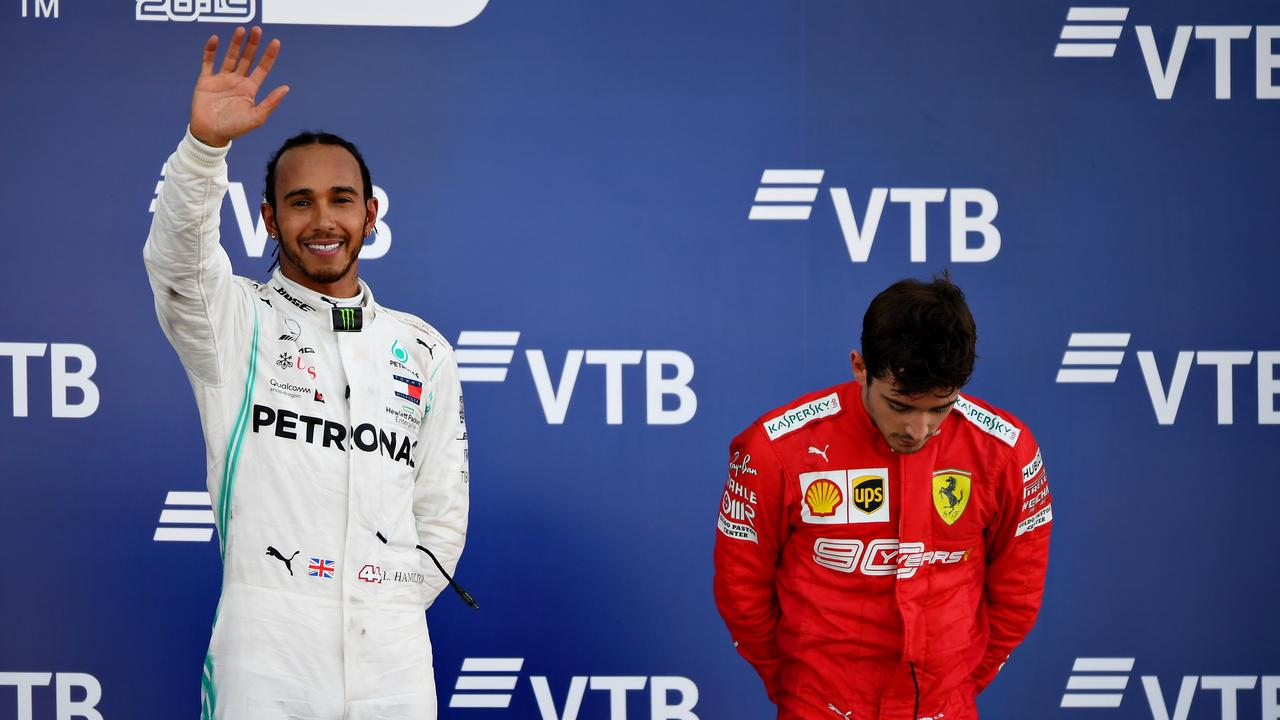 A dejected Charles Leclerc (R) on the podium with winner Lewis Hamilton. (Photo by Picture: Clive Mason