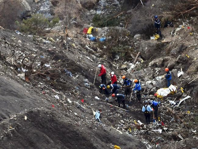Crash site ... French gendarmes and investigators sort through the debris after Germanwings Airbus A320 crashed in the French Alps above the southeastern town of Seyne. Picture: AFP/Anne-Christine Poujoulat
