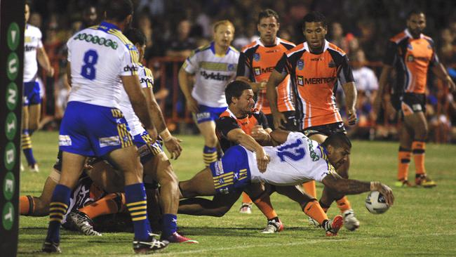Manu Ma'u grounds the ball to score a try in the NRL for the Eels against Tigers.