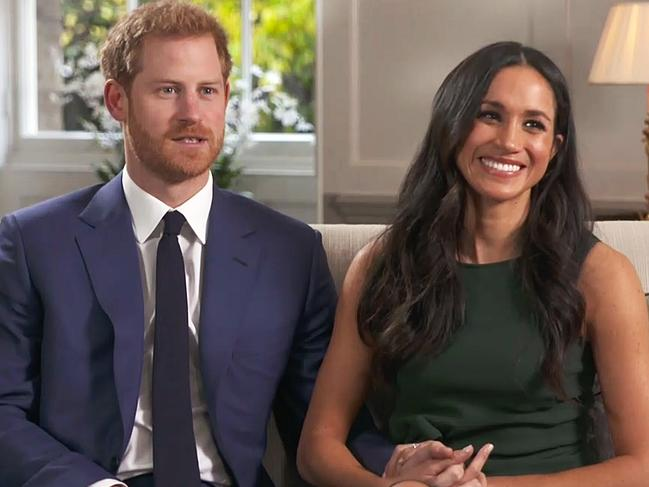 Harry and Meghan (wearing the same P.A.R.O.S.H dress) pictured during their interview after announcing their engagement on November 27, 2017.