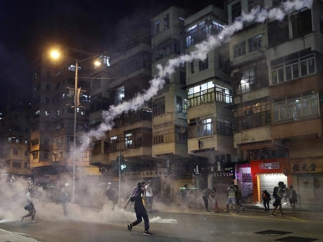 Protesters react to tear gas. Picture: AP