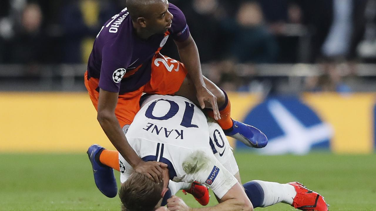 Tottenham's Harry Kane, right, is fouled by Manchester City's Fernandinho
