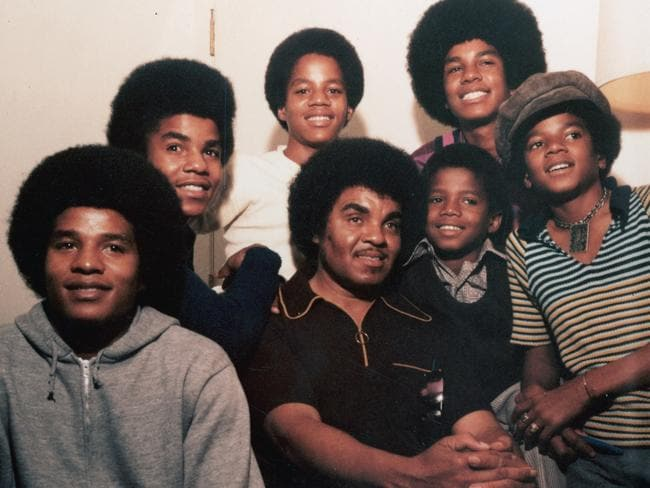 Joe Jackson surrounded by his sons Michael (at right), Jackie, Tito, Marlon, Jermaine and Randy in 1971.