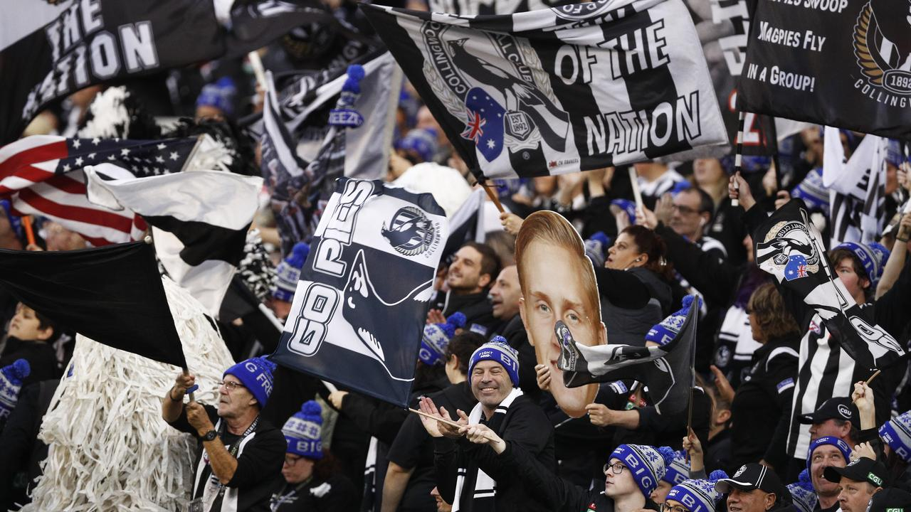 Magpies fans cheering during the Queen's Birthday win over Melbourne. (AAP Image/Daniel Pockett)
