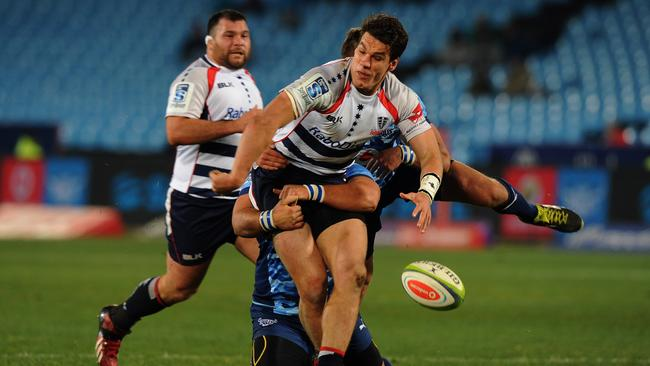 Mitch Inman of Rebels is tackled by Handre Pollard and Morne Mellet.