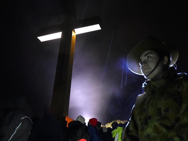 Solemn occasion ... Anzac dawn service at Mt Macedon Memorial Cross. Picture: Jay Town.