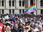Same-sex couples and their friends and family gather at Queens Gardens in Brisbane this morning to watch the SSM result announced live by the ABS. Picture: Peter Wallis