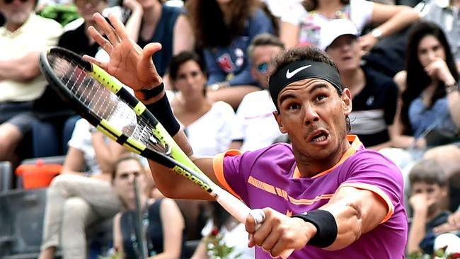 Rafael Nadal of Spain hits a return to Dominic Thiem of Austria during their quarter-final tennis match at the ATP Tennis Open tournament in Rome.