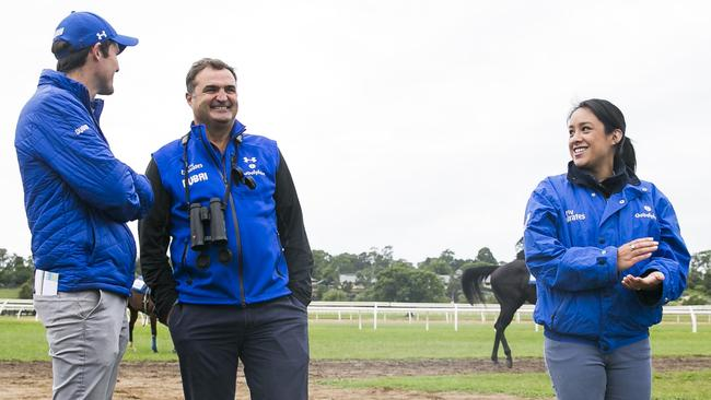 James Cummings, Godolphin Australia's managing director Vin Cox and Cummings' wife Monica share a laugh at trackwork. Picture: Dylan Robinson