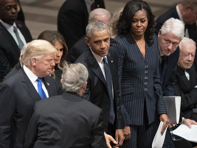 Former president George W. Bush greets the Trumps, the Obamas, and the Cllintons. Picture: AP
