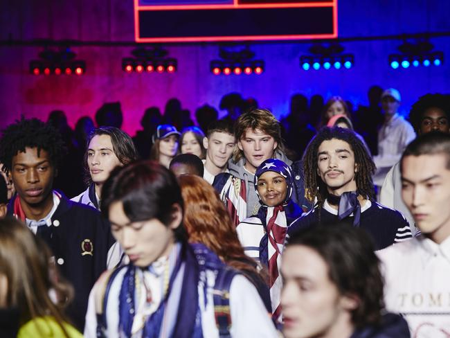 Jordan Barrett and Halima Aden among a sea of models backstage in London. Picture: Getty Images for Tommy Hilfiger