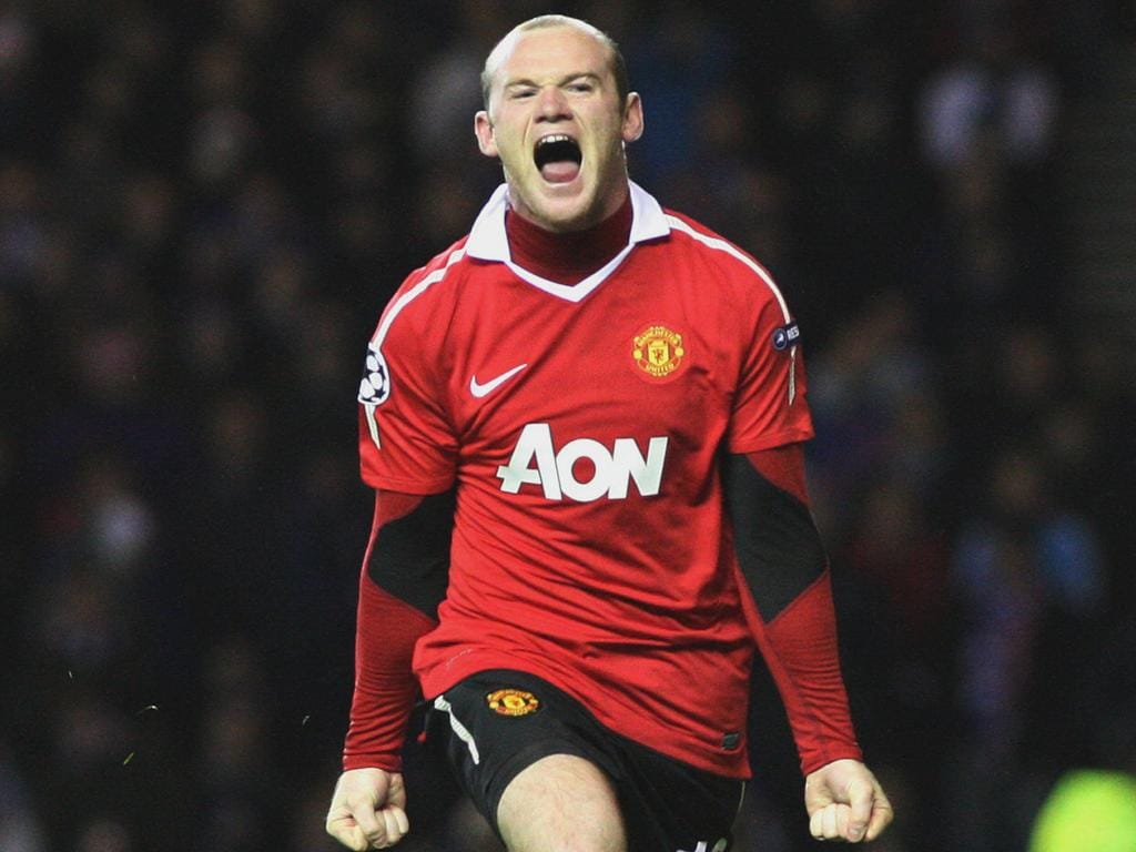 Manchester United's Wayne Rooney, celebrates his goal during their Champions League Group C soccer match against Rangers' at Ibrox, Glasgow, Scotland, Wednesday Nov. 24, 2010.(AP Photo/Scott Heppell)