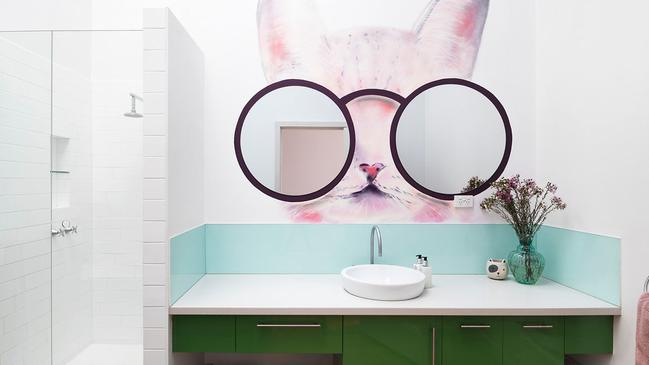 A funky feline is sporting glasses in the bathroom.