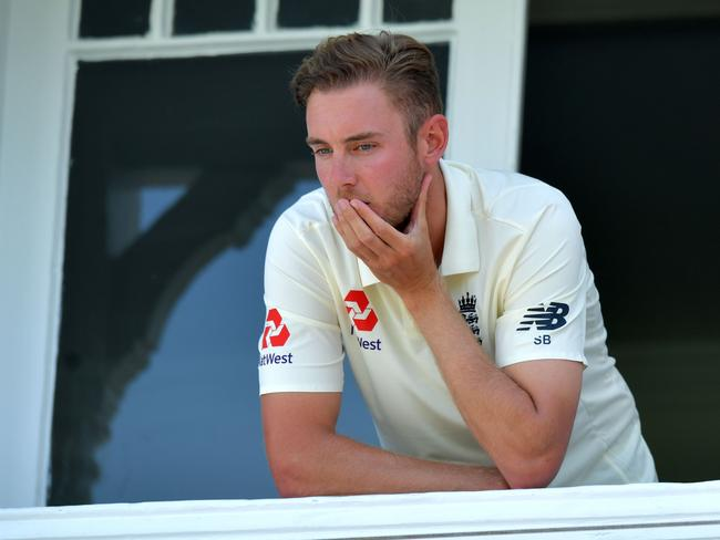 England's Stuart Broad looks out from the dressing room balcony as South Africa claim victory.