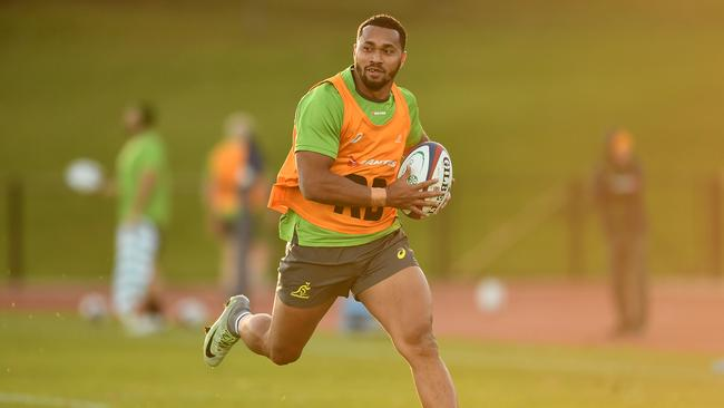 Wallabies winger Sefanaia Naivalu runs with the ball during an Australia training session at Harrow School in London. Picture: Getty Images