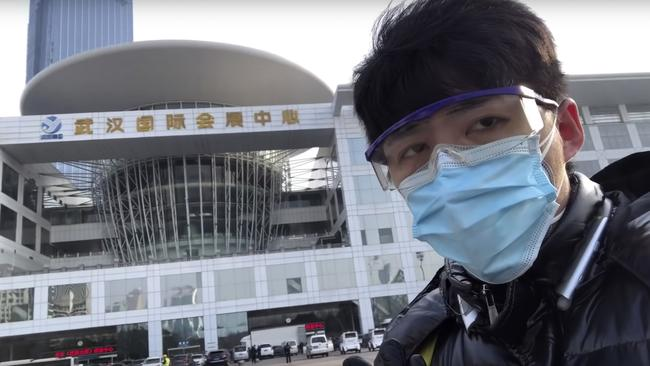 In this image from a video taken February 4, Chen Qiushi speaks in front of a convention centre-turned makeshift hospital in Wuhan amid the viral epidemic. Picture: Chen Qiushi via AP