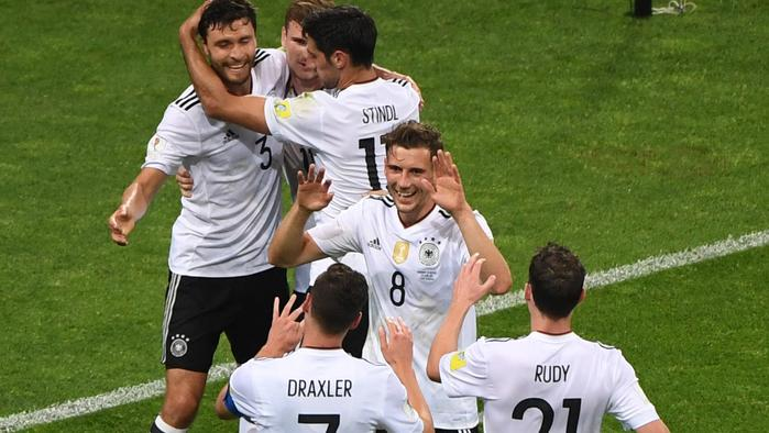 Germany's forward Timo Werner (2L) celebrates with team mates after scoring during the 2017 Confederations Cup semi-final football match between Germany and Mexico at the Fisht Stadium in Sochi on June 29, 2017. / AFP PHOTO / Patrik STOLLARZ
