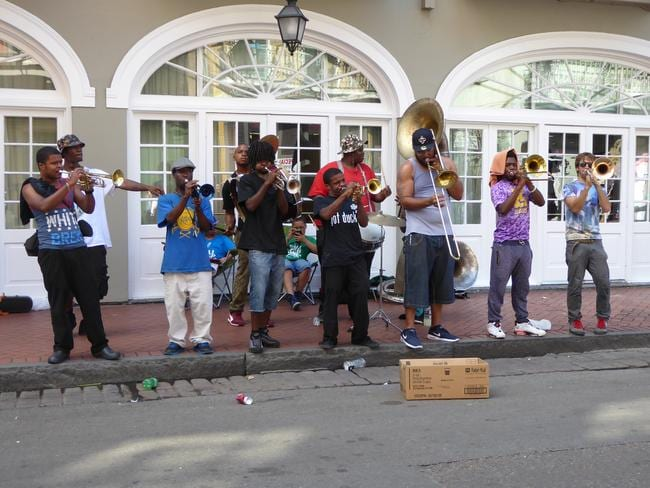Buskers in Bourbon St helping keep the city's spirits up. Picture: Angela Saurine