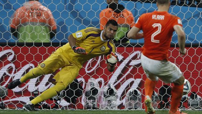 Argentina's goalkeeper Sergio Romero (L) makes a save against Netherlands' defender Ron Vlaar.