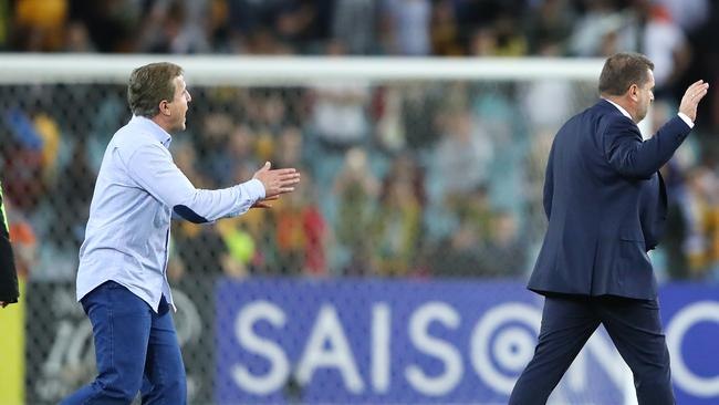 Syria Coach Ayman Al Hakim and Australia Coach Ange Postecoglou exchange words.