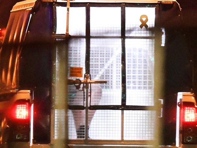 A man is seen being taken away in a police van. Picture: Keri Megelus